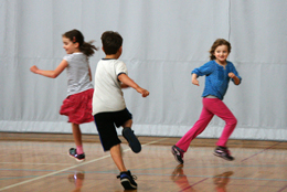 Kids running in gym