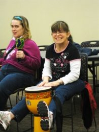 Recreation inclusion playing bongos